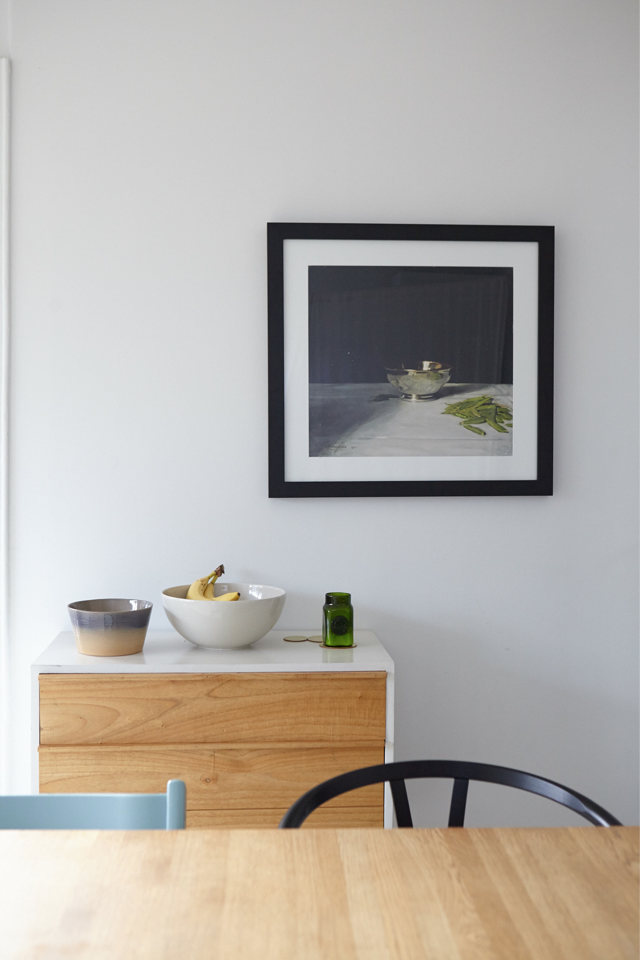 A favourite artwork in the kitchen with the table by Tom Dixon for Habitat, Tripp Trapp Chair from Nature Baby and Wishbone Chair from Cult